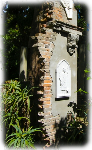 This cracked wall with exposed bricks was part of the inspiration to build the Secret Garden at Uccello Lane