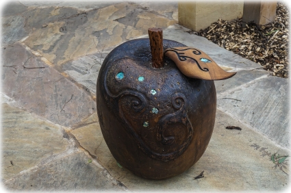 Hand carved apple with abalone shells - heavy and with amazing detail